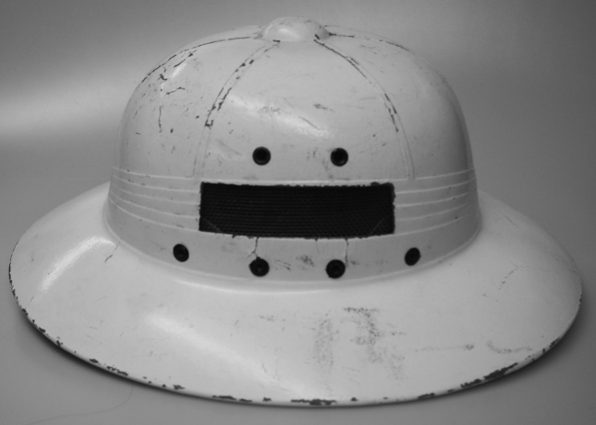 "Another ""experimental"" sun helmet, this is an International Hat Company helmet that was modified to offer increased ventilation. A screen has been riveted to the side of the helmet to keep insects out (Author's Collection)."