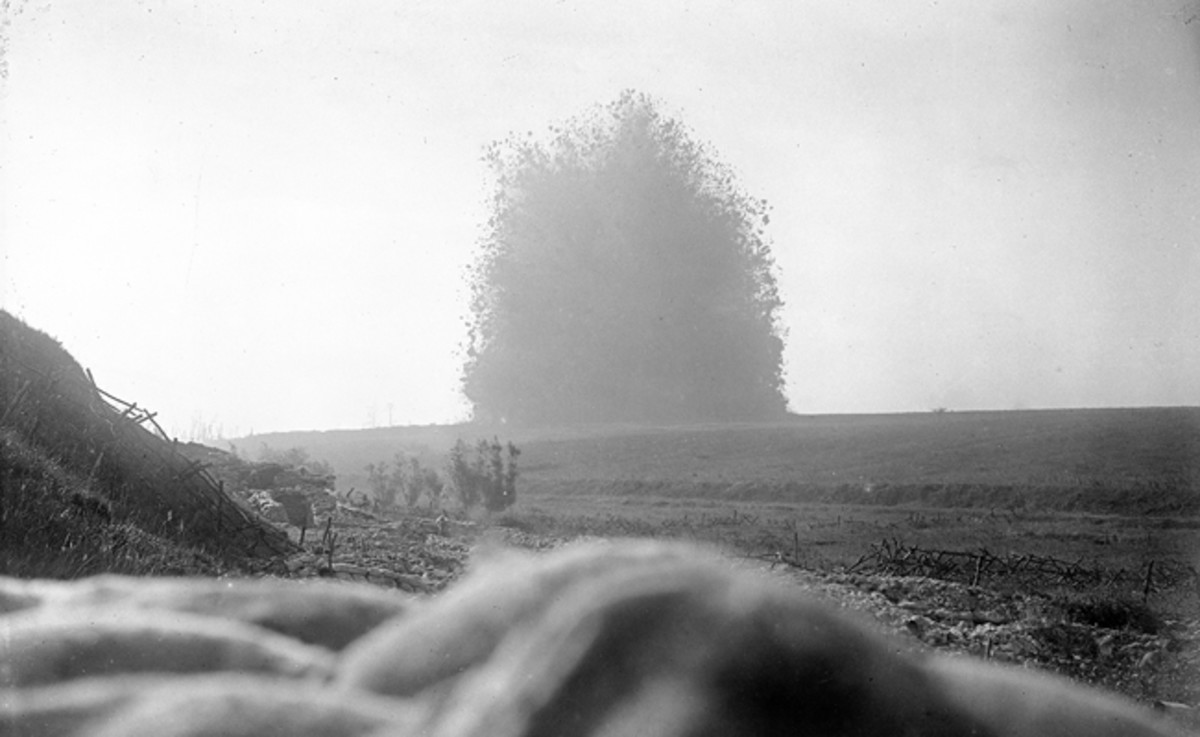At 07.20, a full ten minutes before zero hour, 40,000 pounds of explosives are detonated beneath the German strong point at Hawthorne Redoubt, Beaumont Hamel. The 10-minute delay between blowing the huge mine and zero hour was to prove disastrous, giving the Germans time to regroup before the British advance.
