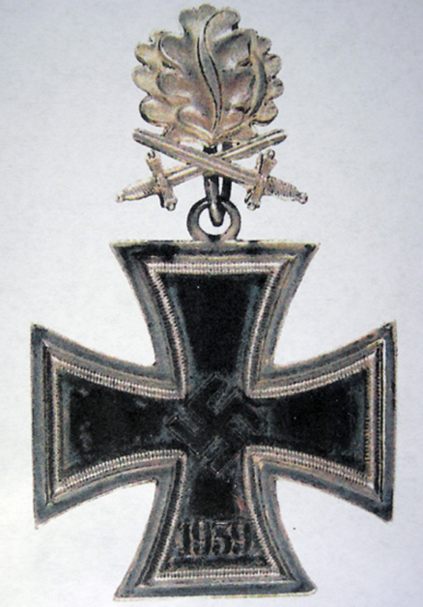 "The ""Diamonds"" are usually attached to the Knight's Cross when worn. It also needs to be noted that this is done via the loop of the device which is made of silver."