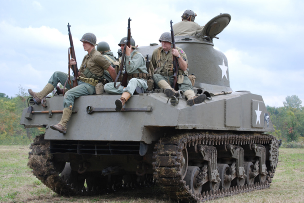 Infantry catching a ride the front on Harold Bottolfson's M4 medium tank.