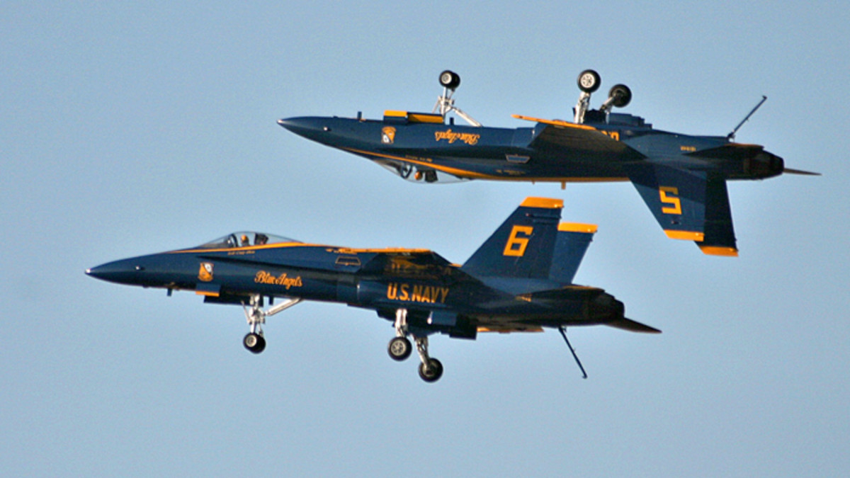 The Navy Flight Demonstration Squadron (Blue Angels) performs at the Blue Angel's Homecoming show ending the 2004 season in Pensacola, Fla. (Photo by PH2 Mark A. Ebert.)