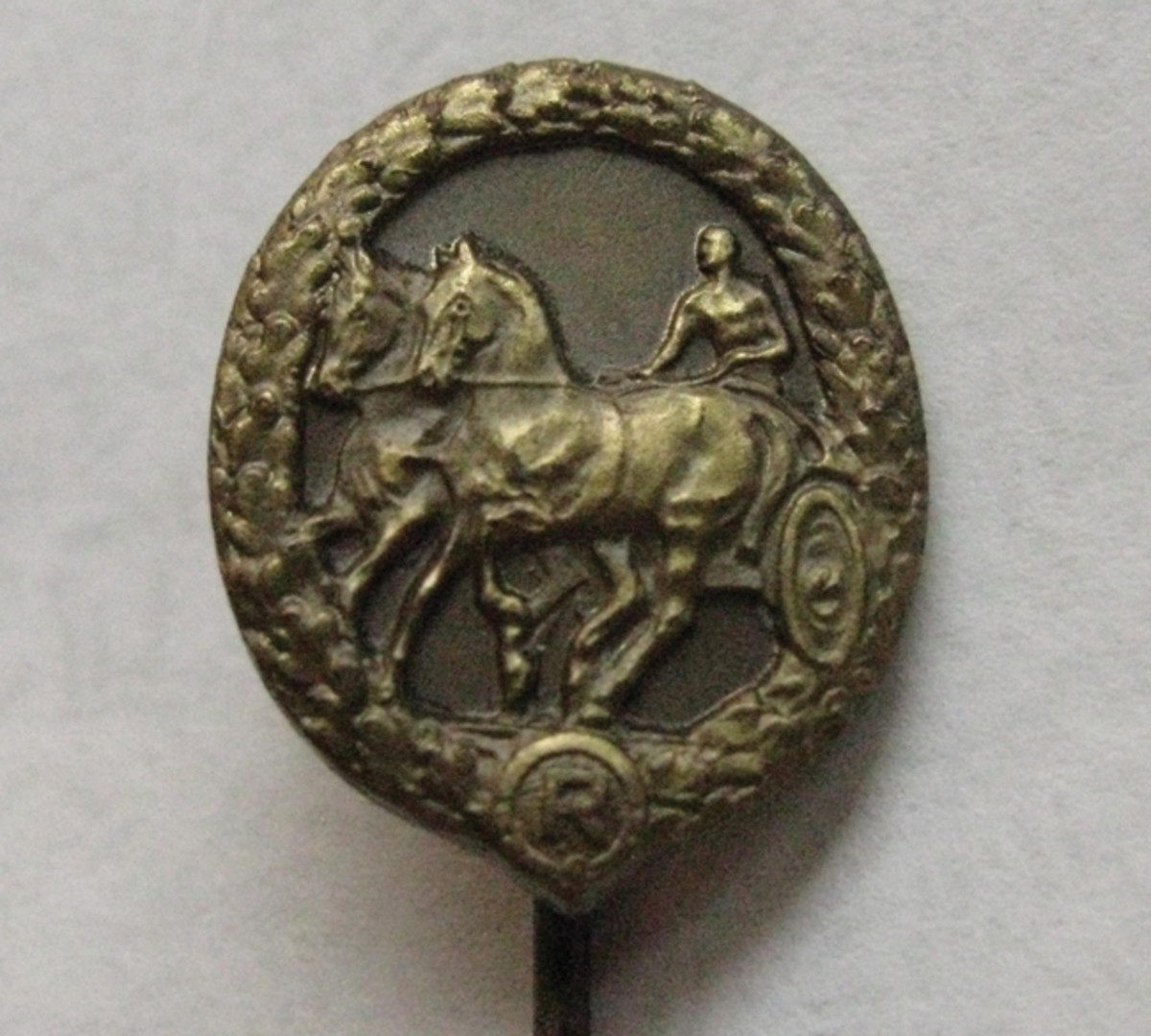 The miniature German Driver's Badge was issued with the full sized award. The miniatures were often worn on civilian clothing.