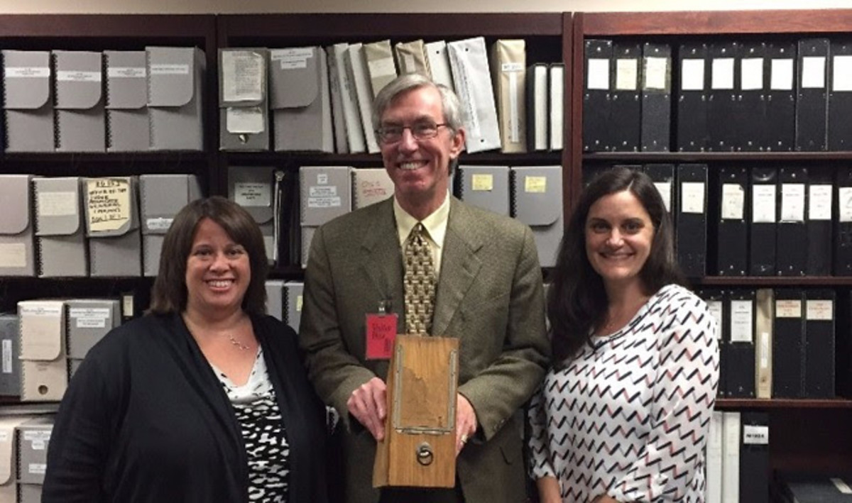 National Archives Catalog Community Managers Suzanne Isaacs (left) and Meredith Doviak (right) with Alex Smith. Mr. Smith is holding a 19th century example of a wooden box used for the storage of records.