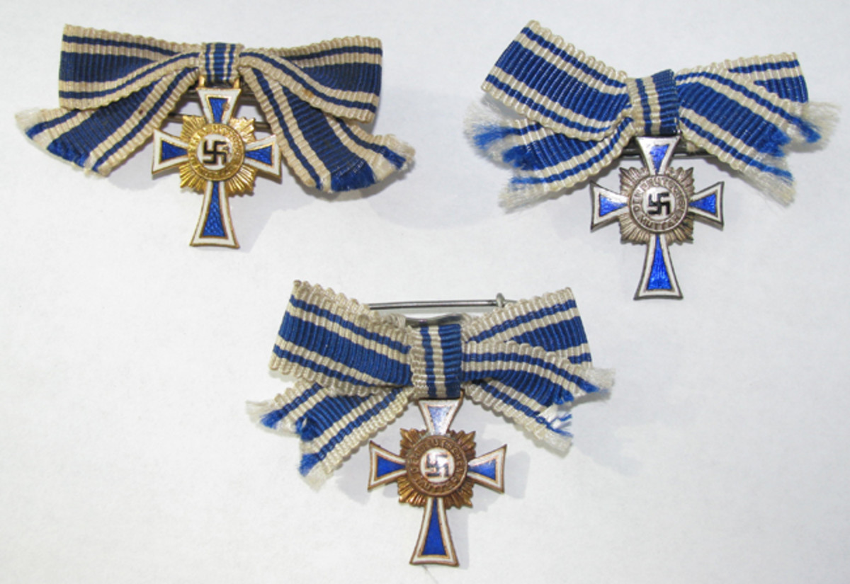 Miniature Crosses were substantially smaller than the regulation medals. Suspended from ribbon bows, miniature Mother's Crosses were much easier to wear than the bulky, full-sized awards.