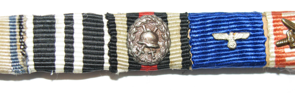 Custom ribbon bars could include miniature devices such as a silver would badge.