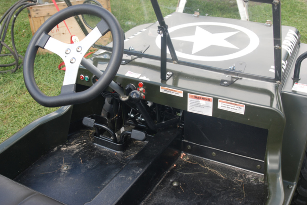 The Meep has a 3-speed ATV-style transmission, seat belt, mirrors, functioning directionals, horn, and headlights.