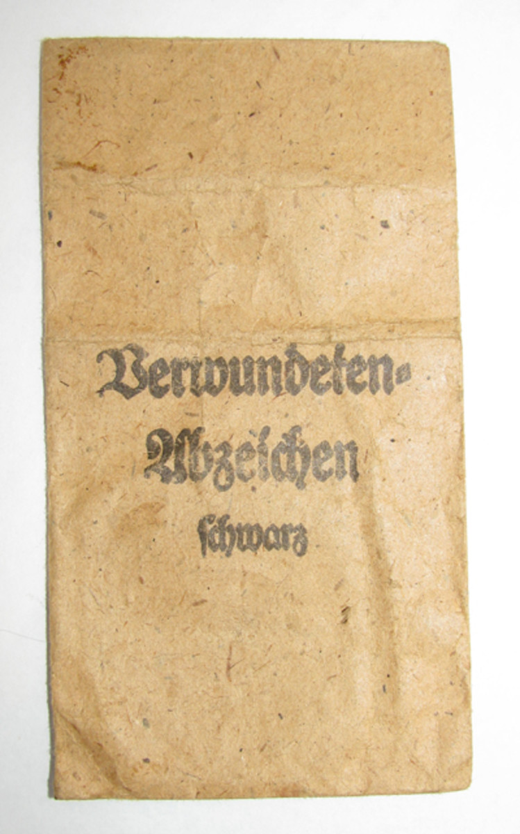 """The third class badge came in an envelope with"""" Verwundetenabzeichen Schwarz"""" (Wound badge - black) printed on the outside"""