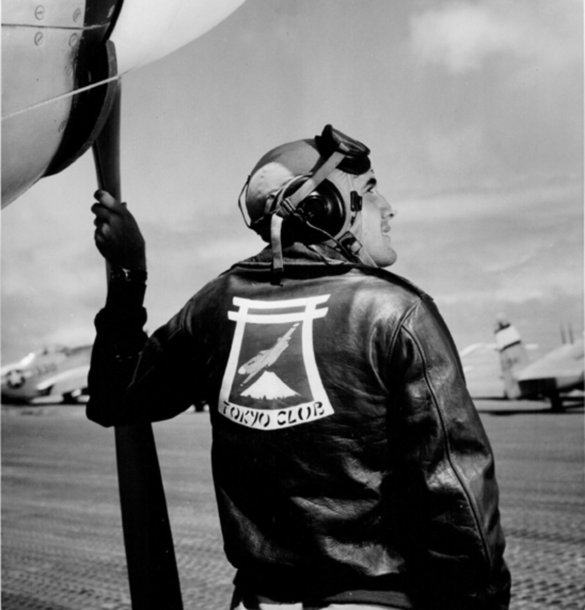 First Lieutenant William F. Savidge, Jr., of Tamaqua, Pennsylvania, proudly wearing his A-2 jacket with the club's insignia painted on the back. The emblem features a Mustang flying over Fujiyama —Japan's iconic mountain, and framed by a Shinto design. Where do you suppose his jacket is today?