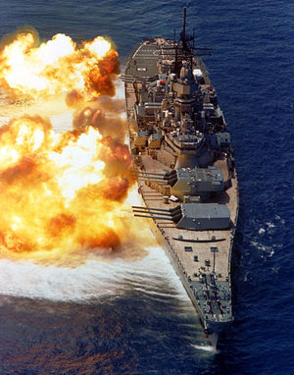USS Iowa (BB-61) fires her 16-inch/50-caliber guns on 15 August 1984 during a firepower demonstration after her modernization.