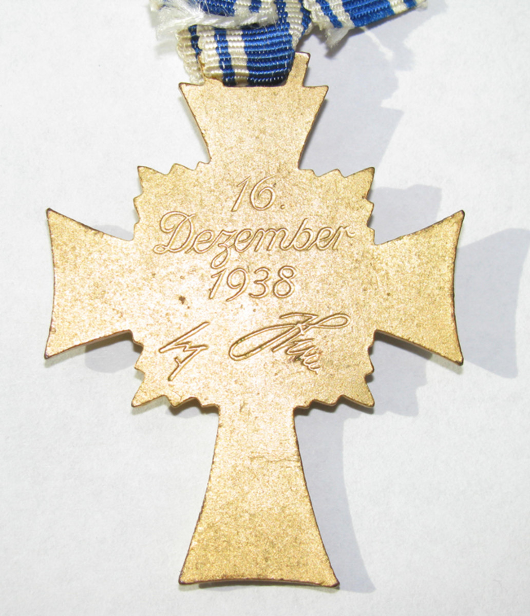 he date, December 16, 1938, and Hitler's signature were stamped into the reverse of the second issue Mother's crosses.