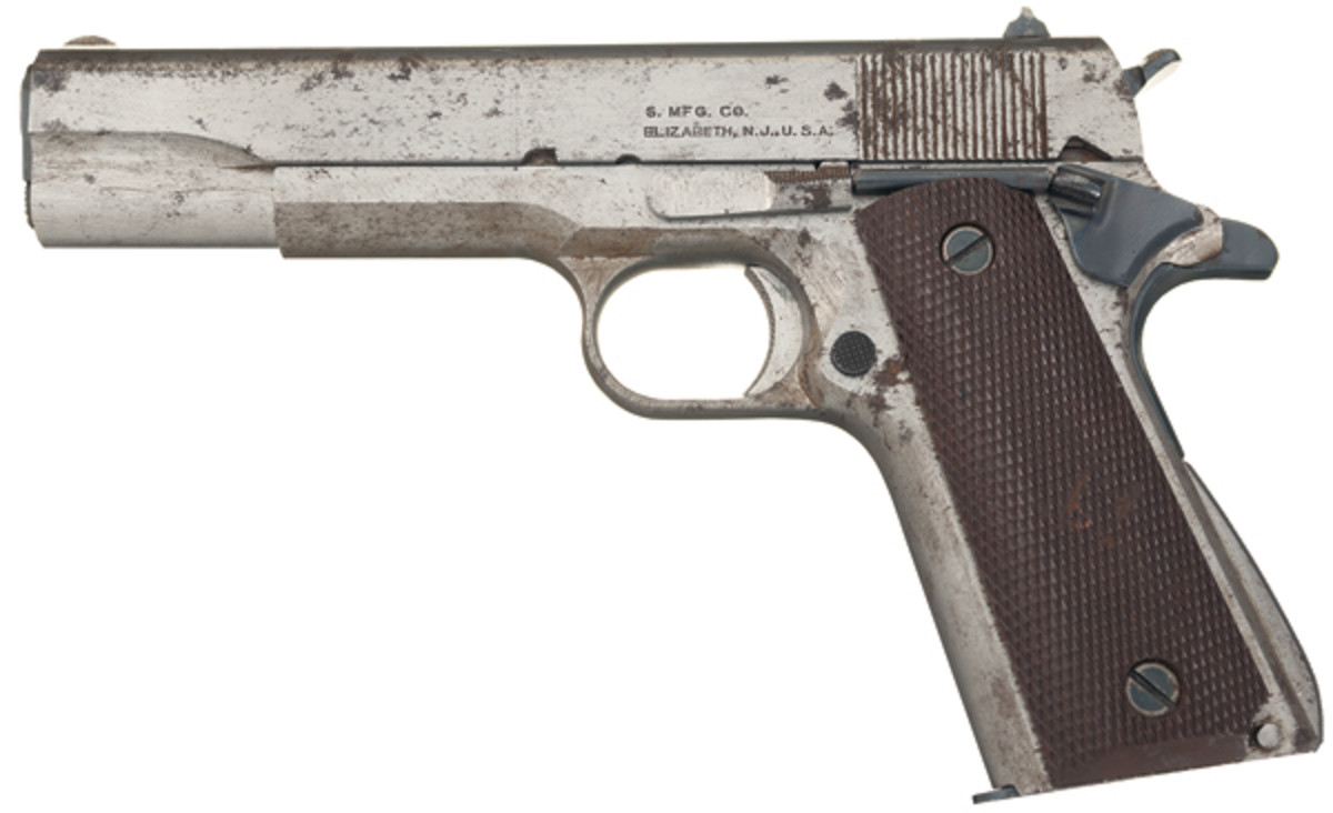LOT 3591: Rare World War II Singer Tool Room/Prototype M1911A1 Semi-Automatic Pistol with Documentation. SOLD: $43,125.