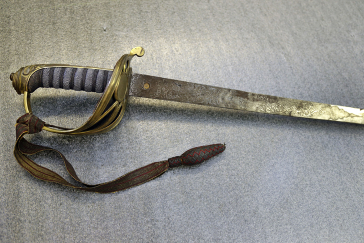 "A British-made sword inscribed with initials ""RGS"" was found in the basement of a Shaw descendent. A Confederate officer had returned the sword to the family after the War. (AP Photo/Elise Amendola)"