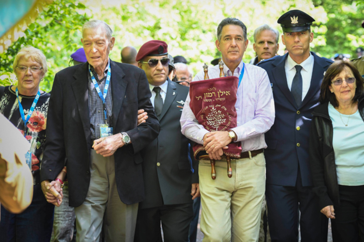 (From left) Lt. Col. (ret.) William Bryant Phelps; FIDF National Director and CEO Maj. Gen. (Res.) Meir Klifi-Amir; FIDF National President Peter Weintraub, holding a Torah scroll; and Head of Israel's Helicopters Air Division Brig. Gen. Yaron Rozen, leading a procession through the Buczyna Forest in Poland, where many Jews, including more than 800 children, were executed and buried by the Nazis.