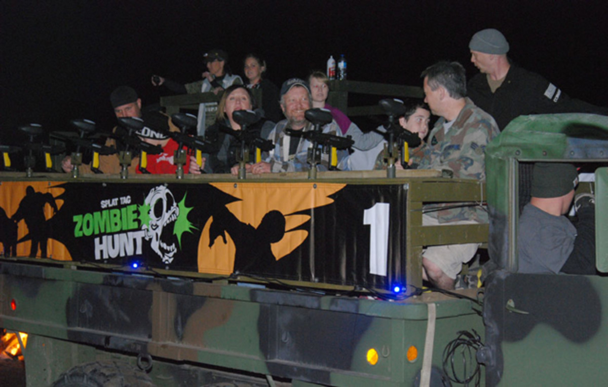 After a group of zombie killers are seated, they receive a safety briefing before heading out into the darkness.