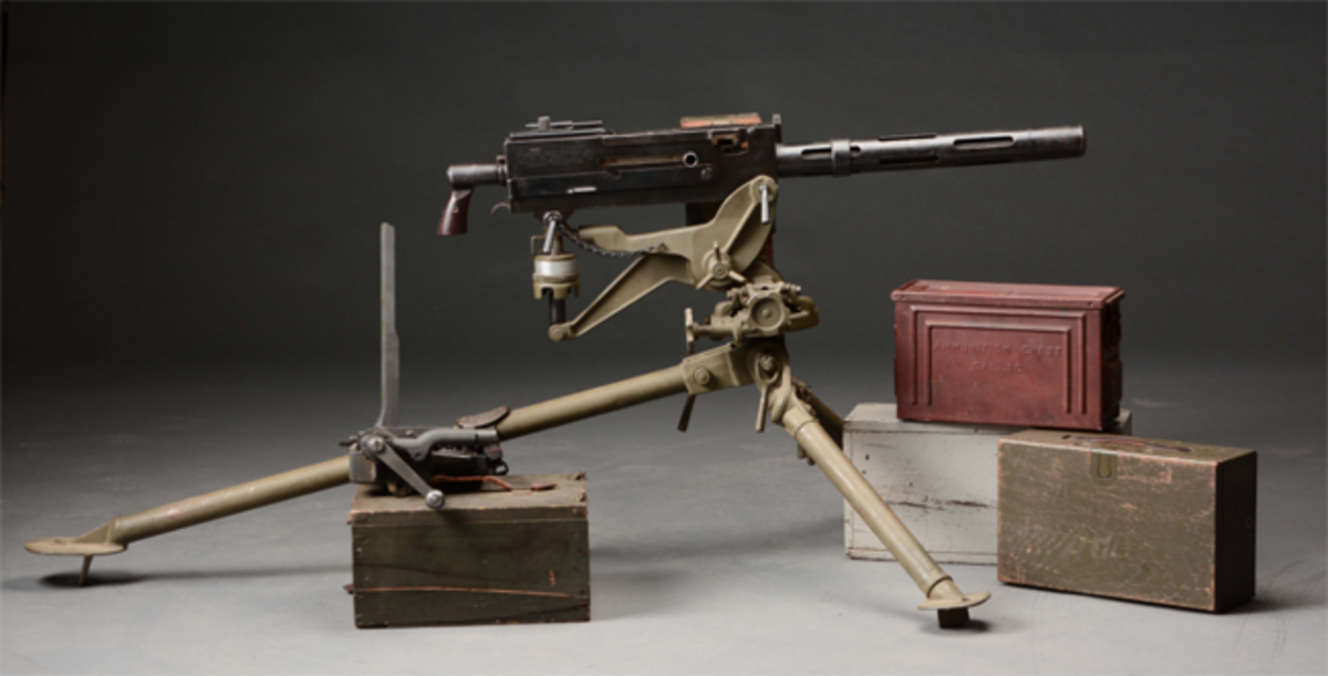 Exceptionally rare US Westinghouse Browning World War I tank machine gun on 1918 tripod, plus belt-loading machine in original box. Est. $30,000-$50,000