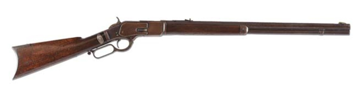 Winchester Model 1873 lever-action rifle attributed to Lakota-Sioux Chief Rain-In-The-Face, who claimed responsibility for killing Gen. George Custer at the Battle of Little Big Horn. Est. $200,000-$250,000