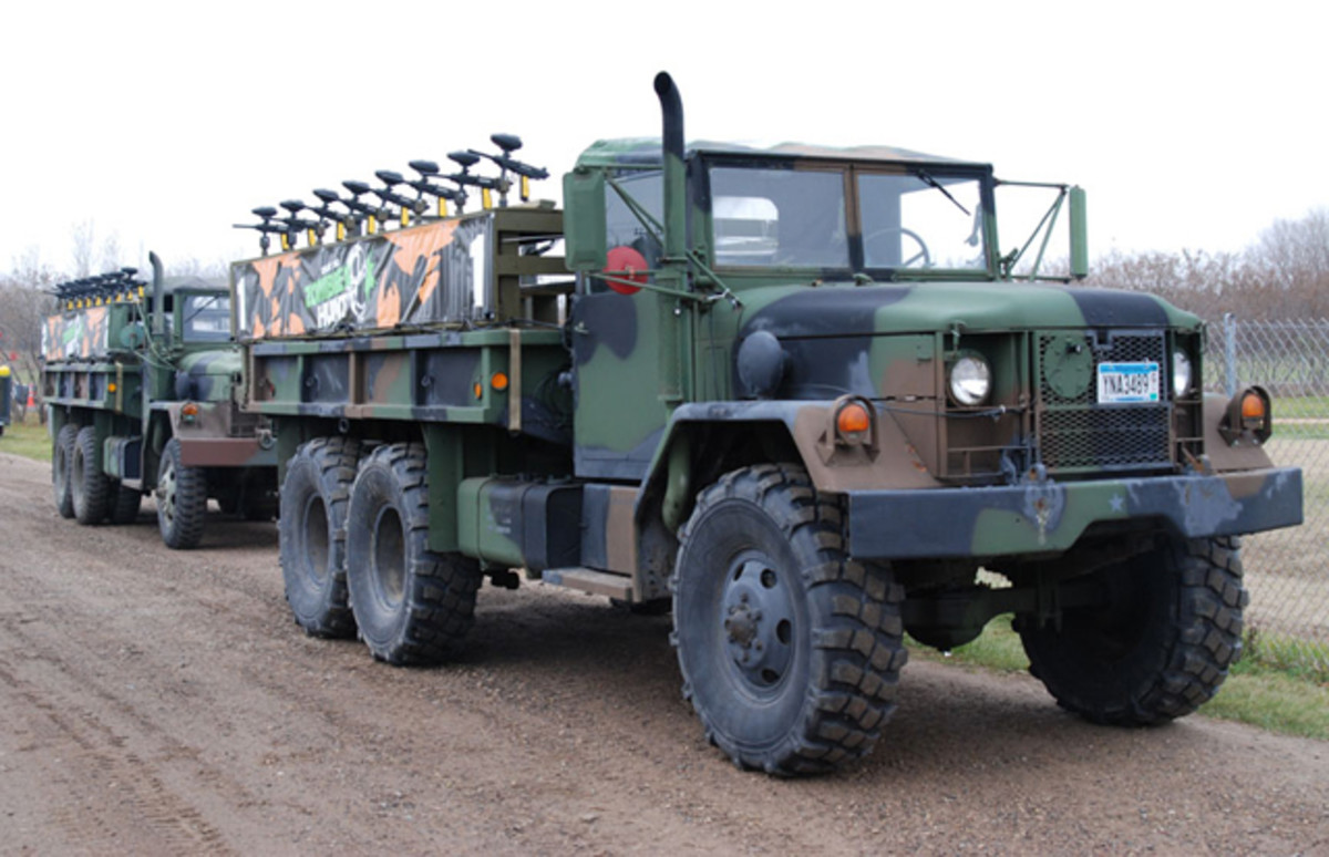 Rick maintains the fleet of five M35s and one M36. Here, two of the trucks are mounted with paintball weapons and ready to go on the hunt!