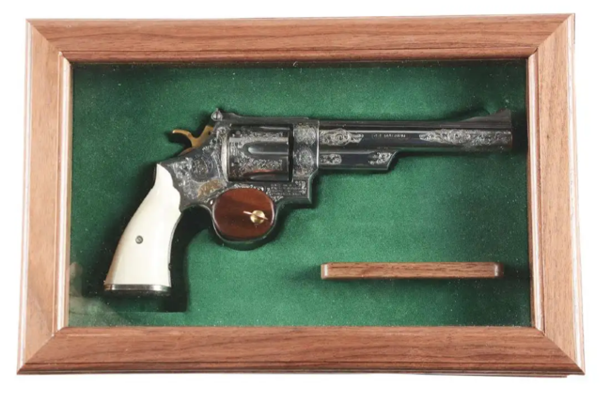 Cased and engraved Smith & Wesson Model 29-2 double revolver. Image - Morphy Auctions