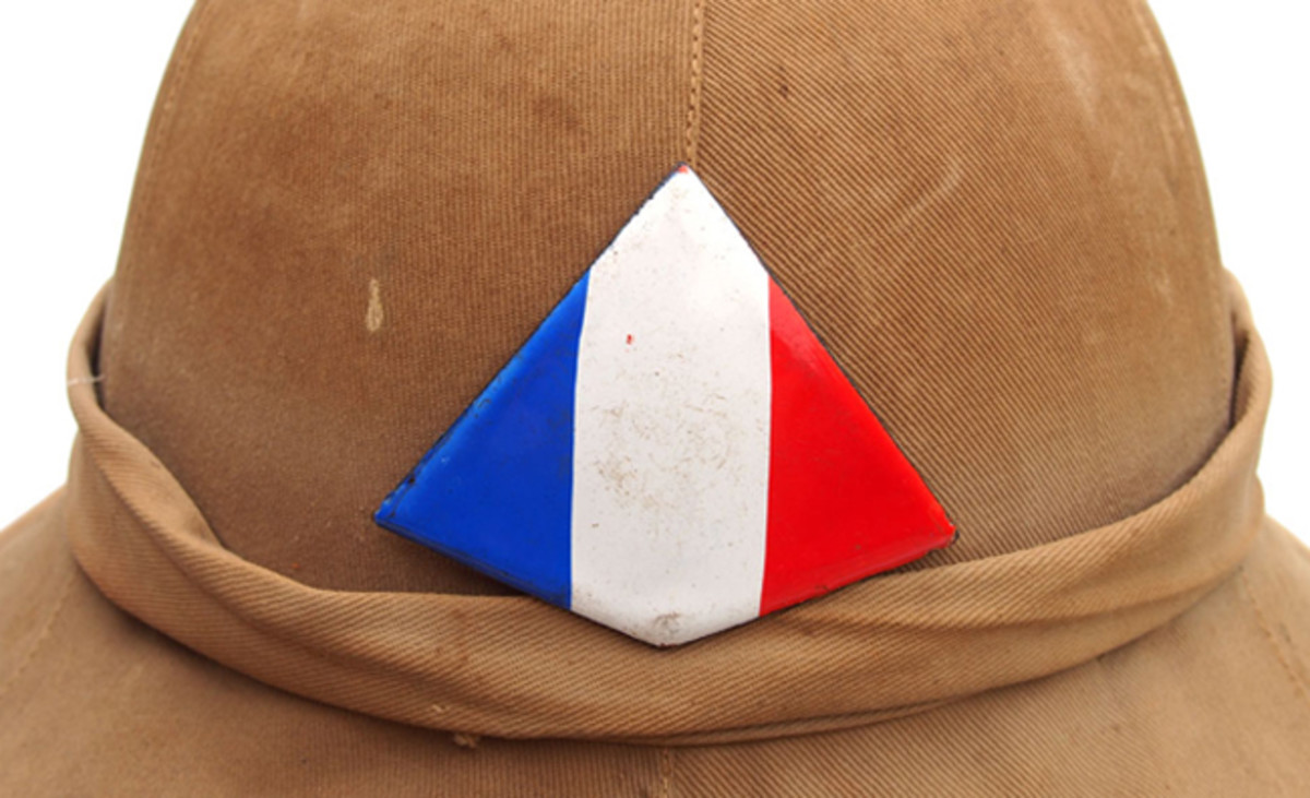 A close up of the Free French helmet plate. These badges have been faked, but originals should be baked on enamel that shows no brush strokes. Author's collection