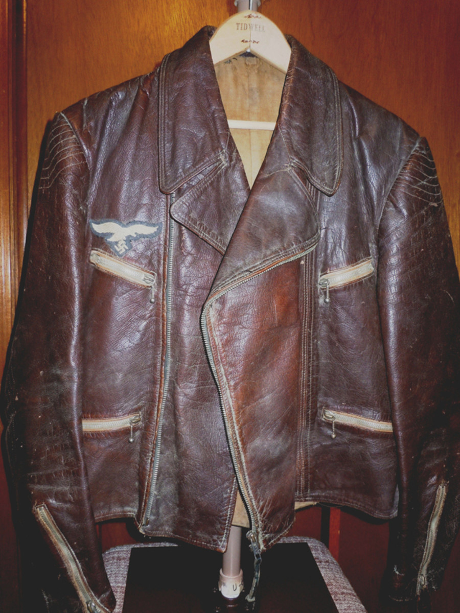 The Luftwaffe leather jacket has four zippered pockets and a Luftwaffe enlisted man's breast eagle. It seems to be in remarkably good condition for its age and the air battles it may have been involved.