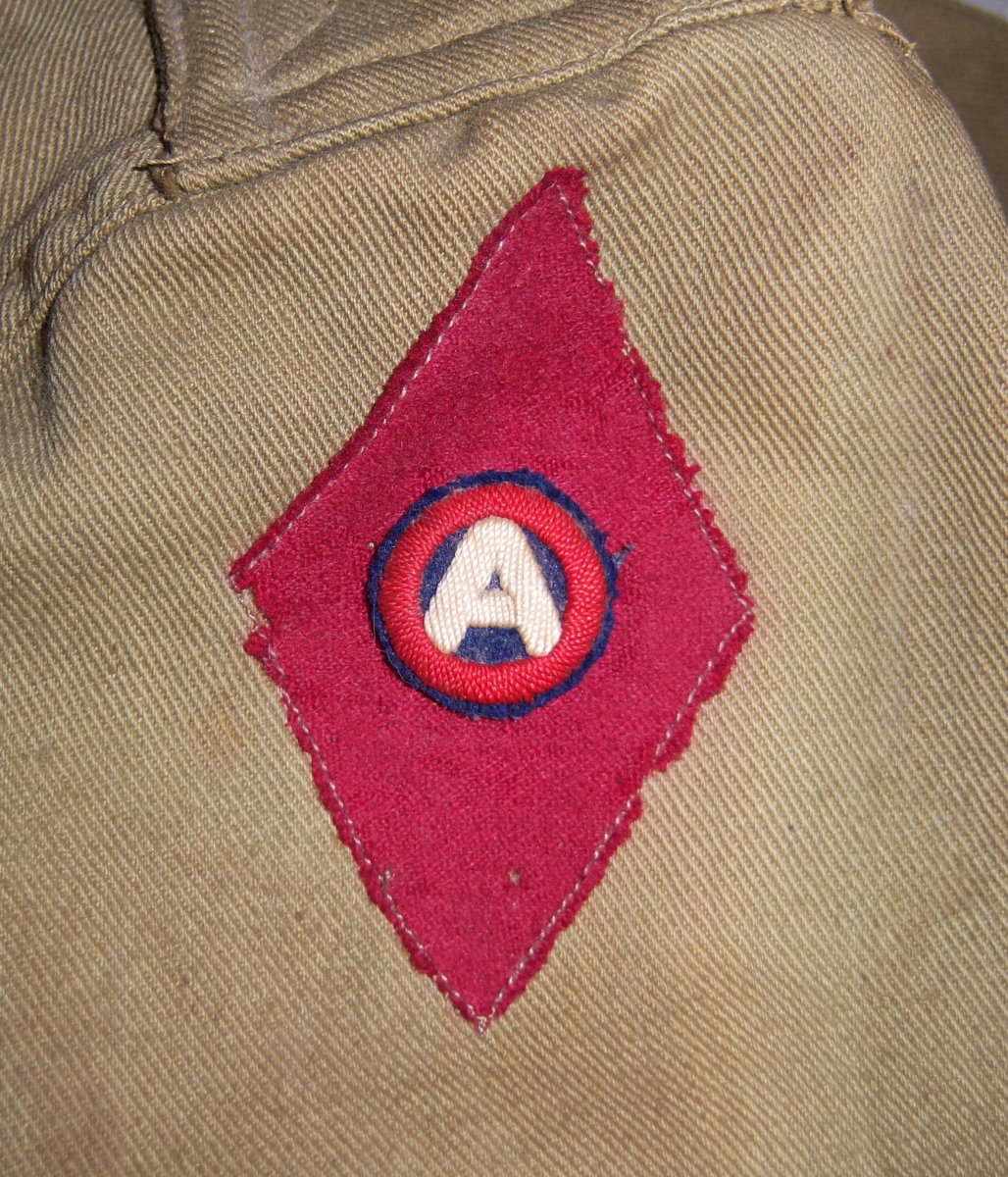 "The 5th Division, another Regular Army unit, served in the occupation of Luxembourg after the war. This 5th Division soldier has chosen to show his Third Army affiliation by placing the small patch inside his ""Red Diamond"" patch."