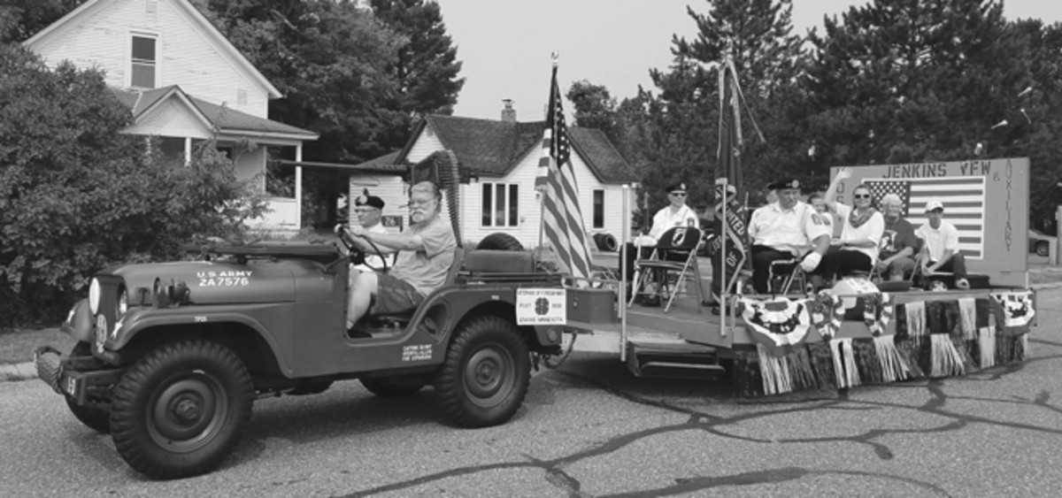 Backus, Minn., 2018 Cornfest Parade. Escorting triple Purple Heart recipient Tex Stafford with the Jenkins VFW float in tow. Photo by Amy Maus
