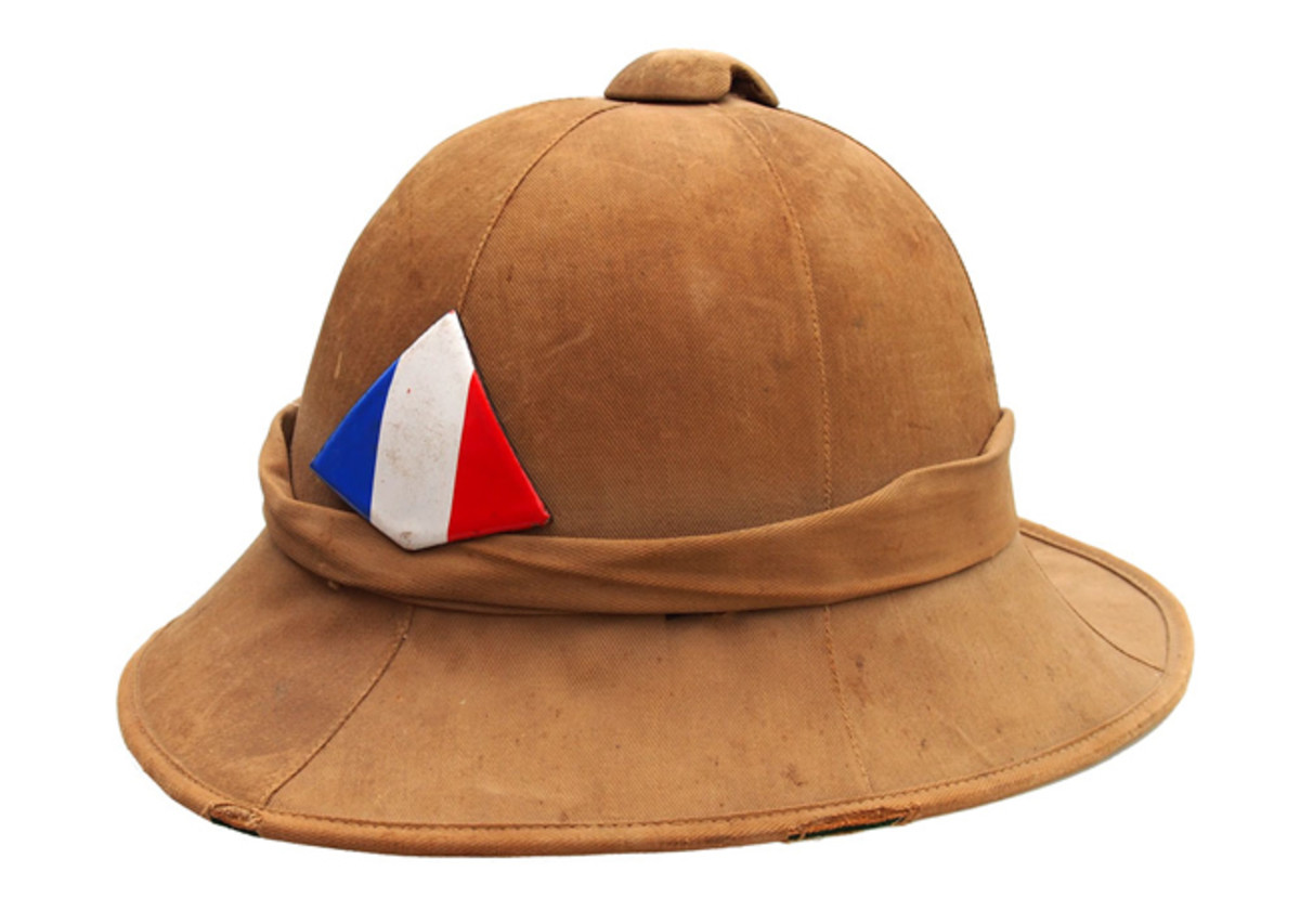 (BELOW) A 1941 produced felt Wolesely with the enameled Free French badge. These helmets were used likely from late 1940 to early 1942 but were not liked by the French soldiers and soon taken out of service. Author's collection