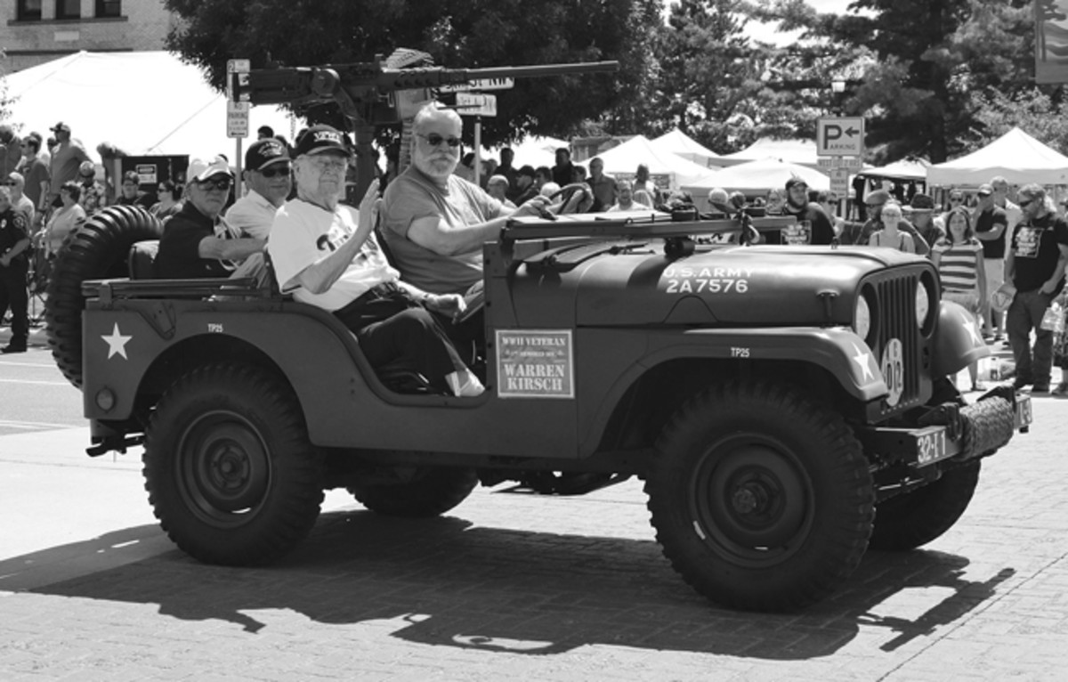2017 Grand Rapids Tall Timber Days Parade.-Escorting WWII veterans Warren Kirsch and Art Fleischhackker. America's Greatest Generation!