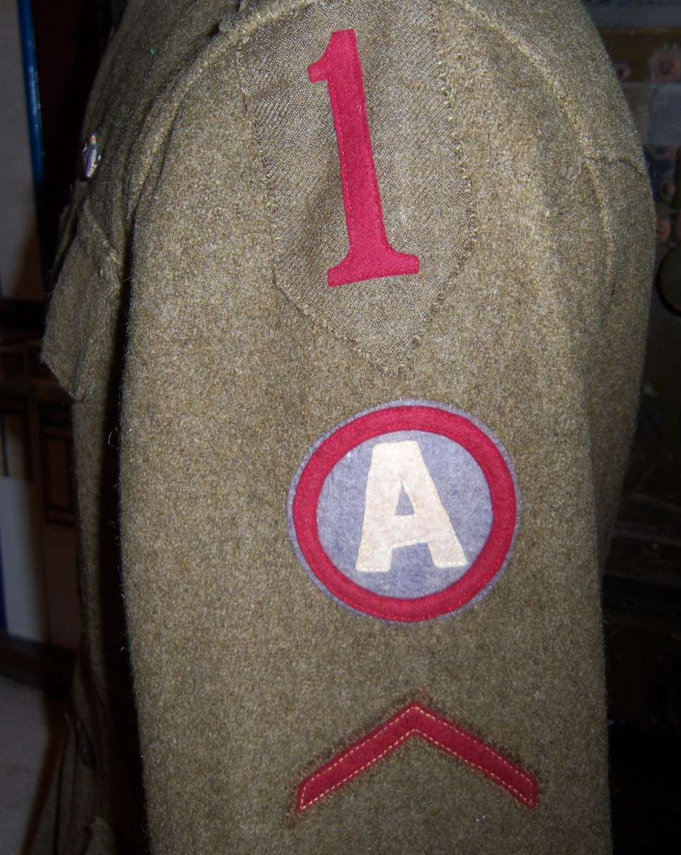 "From the 1st Division comes this uniform coat showing the placement of the Third Army patch directly below the ""Big Red One."" Other 1st Division uniforms have a small Third Army patch sewn directly onto the numeral ""1."""