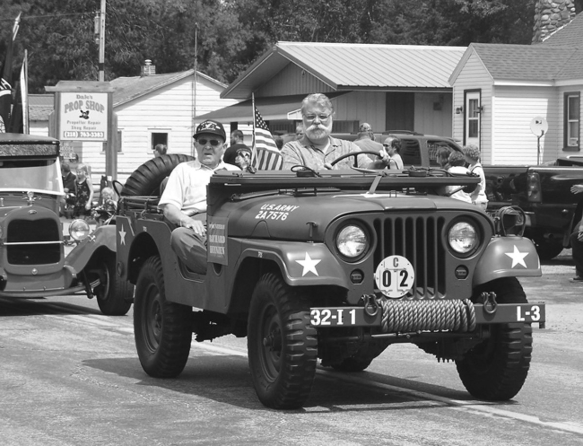 Emily Days Parade, 2014. Escorting WWII Veteran Richard Heizen.