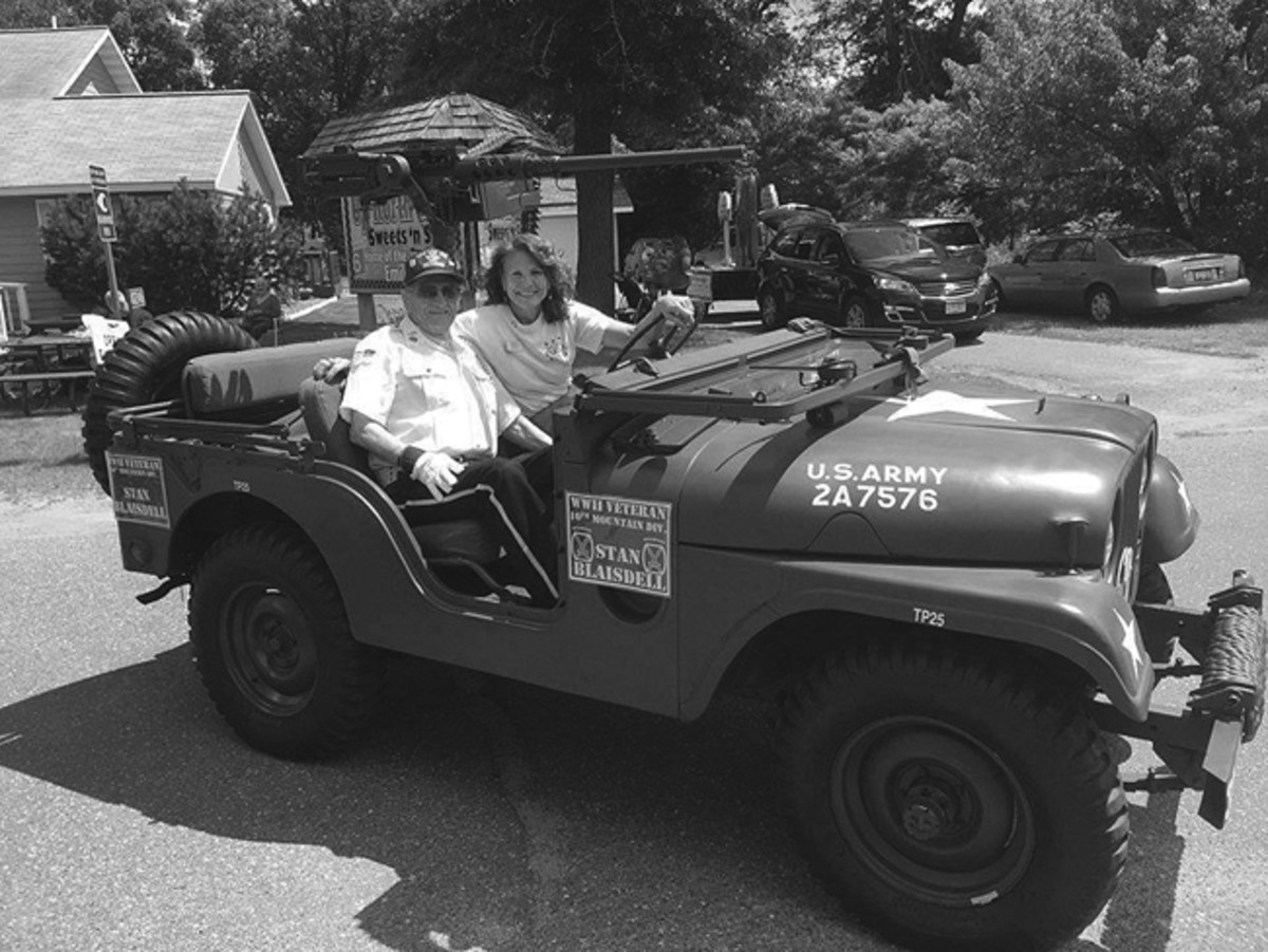 Emily Days, Minnesota, 2016 Parade. Escorting WWII Veteran Stan Blaisdell with our State Senator, Carrie Ruud.
