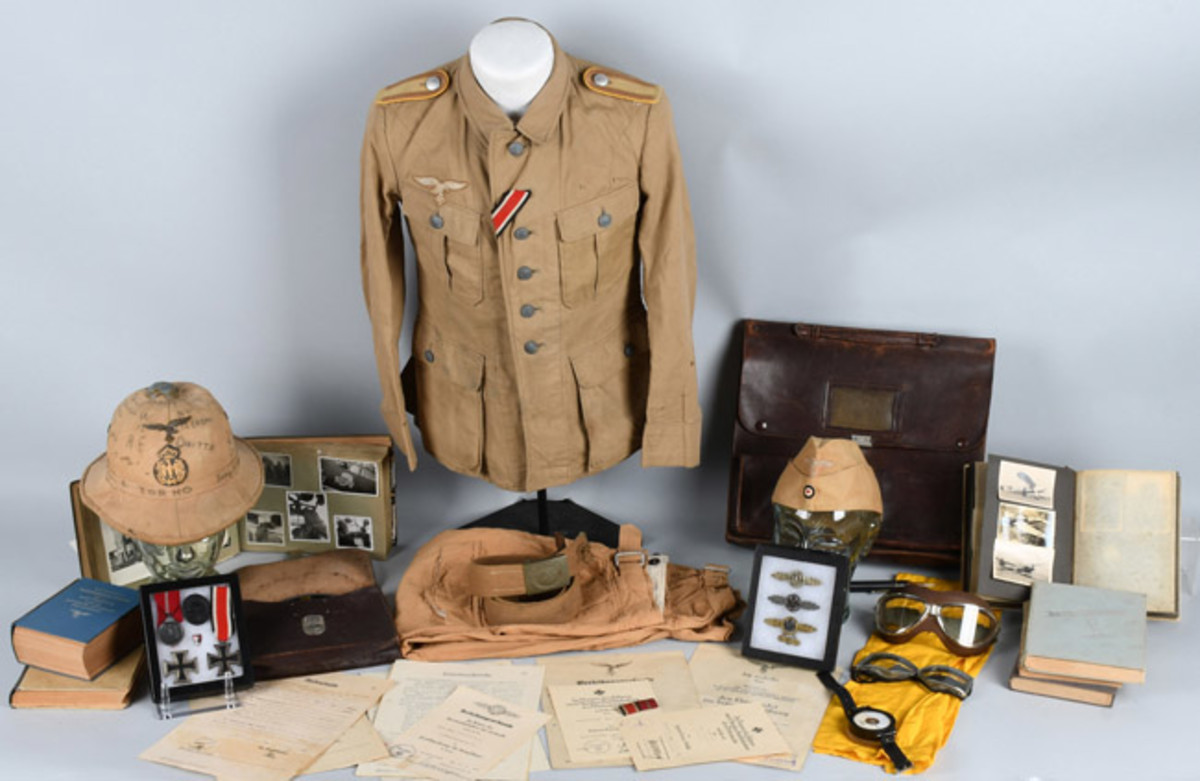ps://www.liveauctioneers.com/item/58862790_wwii-nazi-german-named-luftwaffe-kia-pilot-group Extensive World War II Nazi Germany Luftwaffe pilot's archive that includes military apparel, badges, medals, flight paraphernalia, wartime photo albums, many other items.