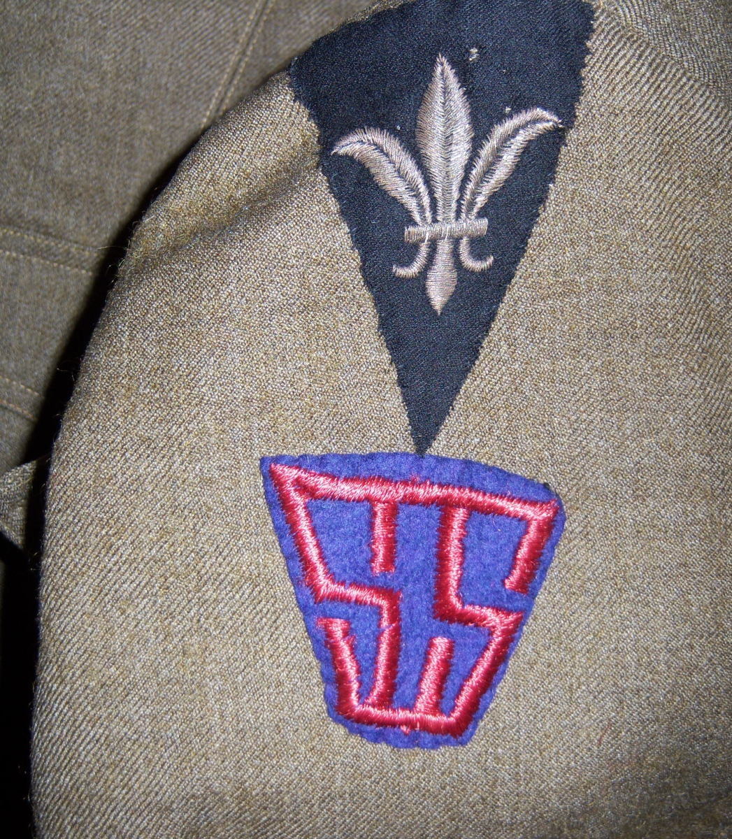 Not to be outdone by the soldiers of the Third Army, this District of Paris Doughboy has added a Services of Supply patch to his uniform.