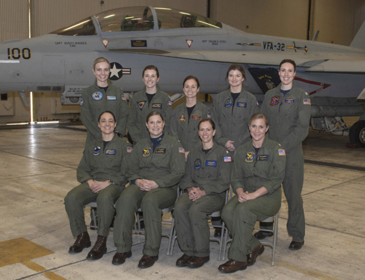 Naval aviators participating in a flyover to honor the life and legacy of retired Navy Capt. Rosemary Mariner pose for a photo in a hangar bay at Naval Air Station Oceana in Virginia Beach, Virginia, Jan. 31, 2019. The U.S. Navy is scheduled to conduct the first ever all-female flyover Feb. 2 in Maynardville, Tennessee as part of the funeral service for Mariner, a female Naval aviation pioneer. Back row, from left to right: Lt. Christy Talisse, Lt. Emily Rixey, Lt. Cmdr. Jennifer Hesling, Lt. Kelly Harris, Lt. Amanda Lee. Front row from left to right: Lt. Cmdr. Danielle Thiriot, Cmdr. Stacy Uttecht, Cmdr. Leslie Mintz, and Lt. Cmdr. Paige Blok. (U.S. Navy photo by Mass Communication Specialist 3rd Class Raymond Maddocks/Released)
