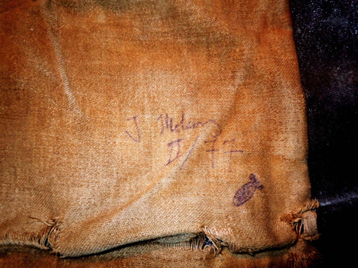 The ink inscription on the inside liner of the Luftwaffe Stuka leather jacket showing on the first line the Pilots name; J Mot…, followed by the Luftwaffe Group; Roman numeral II, and the number 77, presumably the designation of the Stuka Geschwader.