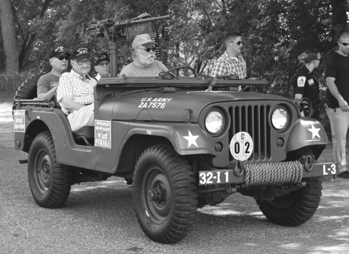 Brainerd, Minn., 2017 Parade. Riding shotgun in the front seat is WWII veteran and Bataan Death March survivor Walt Straka. Walt endured the gruesome 60-plus mile march in which thousands of other soldiers died along the way at the hands of the Japanese army. In back is Ralph Yeager, an 82nd Airborne veteran of North Africa, Sicily, Normandy, and Battle of the Bulge. He is sitting next to Vietnam veteran and Purple Heart recipient, Steve Rosenow. He is a retired Veterans Service officer and is active in the Disabled American Veterans (DAV).