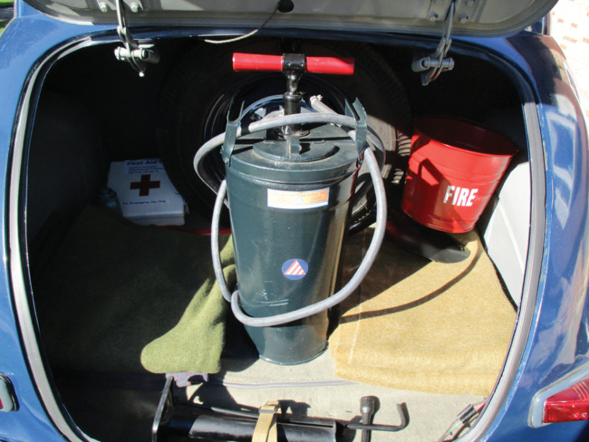 In the trunk, the car features all of the correct equipment that was carried by a CD car during WWII, including the fire extinguisher, first aid kit, fire bucket, shovel, and several blankets in addition to the jack and tool kit.