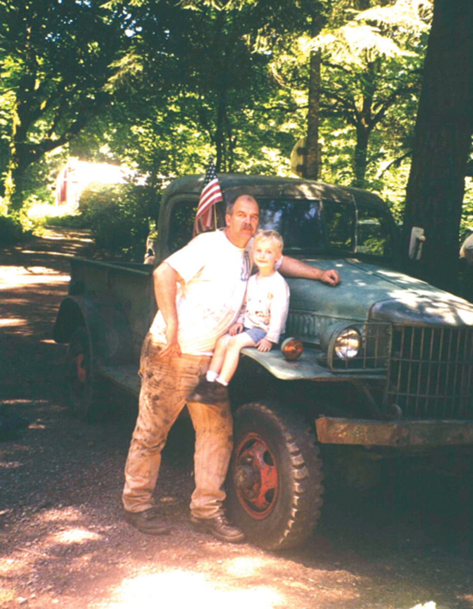 "Mark and a young Gunnar Sigrist greet the ""new"" WC-1 truck upon arrival back in 1998. Gunnar already had the interest in historic military vehicles. This interest has led to a lifetime passion."