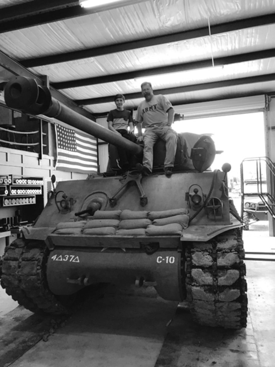 "Here we are just ""hanging out on a fully restored Sherman M4A3A8. The level of restoration and attention to detail was phenomenal. This tank could have just rolled off the assembly line and onto the battlefield."