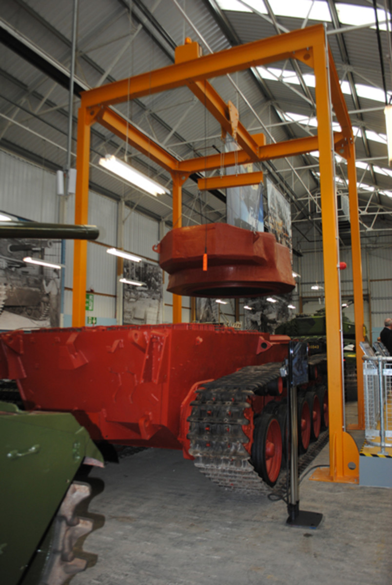 A gantry hoisting a replica turret above a waiting tank chassis gives visitors an up-close sense of the enormity of the operation.