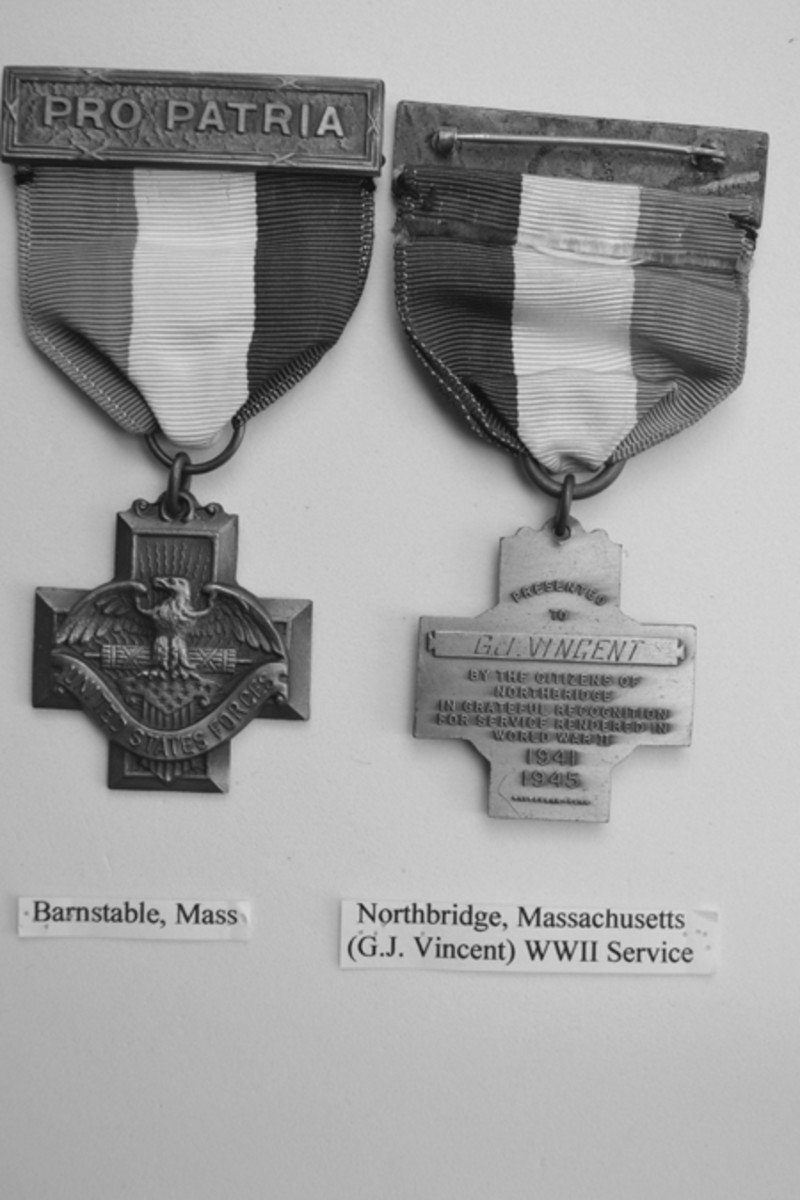The Whitehead Hoag Company Type 4 obverse is shown in the Barnstable, Mass., medal with corresponding reverses of medals issued by other towns with 1941-1945 dates. - Barnstable obverse and Northbridge, Mass., reverse (named and dated)