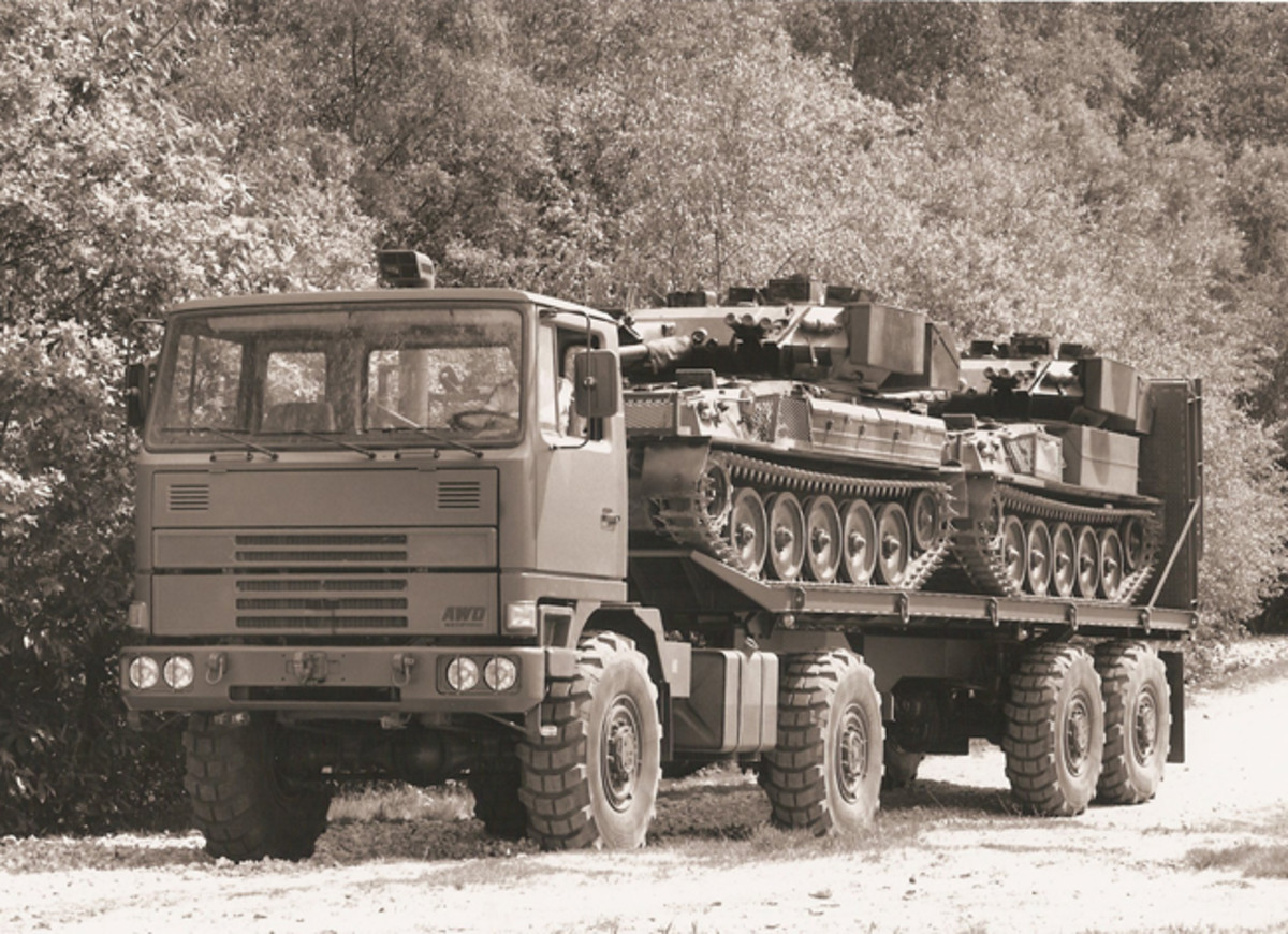 Pair of Scorpion CVR(T)s armed with 76mm guns on transporter taking them to exercise area.