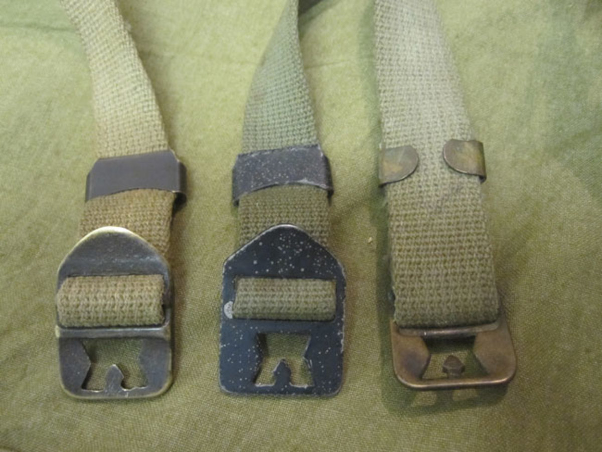 From 1941 to late 1942, the chin strap buckle was made from a brass casting that can be readily distinguished by its brass construction and the raised bar cast into the top of the buckle. After 1942, a simplified buckle was developed to ease construction and conserve brass. The new buckle, stamped out of steel and painted black would remain unchanged for the rest of WWII.