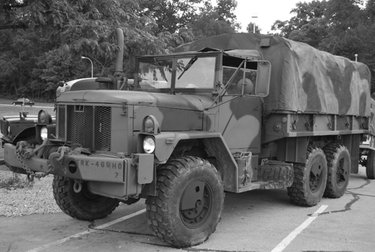 "The M35A3 is the last or present-day generation of M35s. These are not new trucks but are actually upgrades of the Vietnam era vehicles under a plan called The Extended Service Program in which existing trucks were totally disassembled and parts rebuilt as needed. Then the trucks were reassembled, combining both new and rebuilt parts, including some modern systems. As seen here, one of the obvious changes was relocating the headlights from the grille to the fenders. Another is the ""super-single"" tires. The multifuel engines were replaced with Caterpillar diesels. This unit is also fitted with a Central Tire Inflation System (CTIS)."