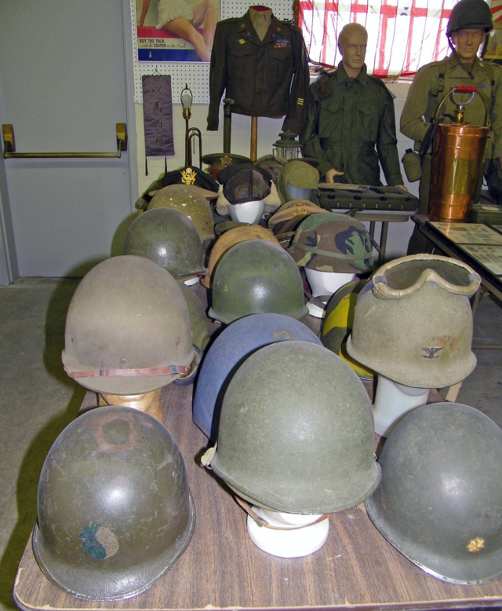 Several military helmets brought high prices, including one with blue & white regiment insignia ($1075).