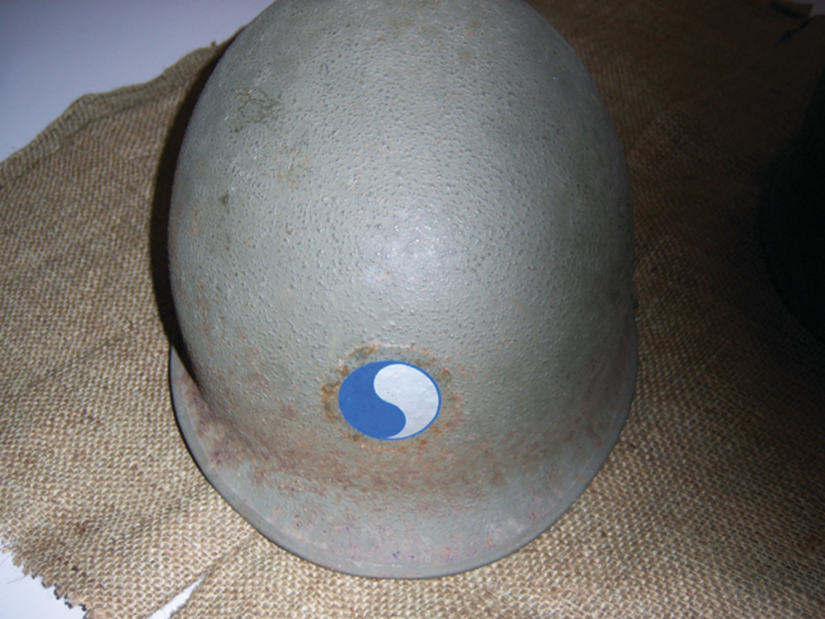 This helmet (#32) is typical of the McCord Style helmets with some surface rust. It is a front seam helmet with a manufacture date of March-April 1944.