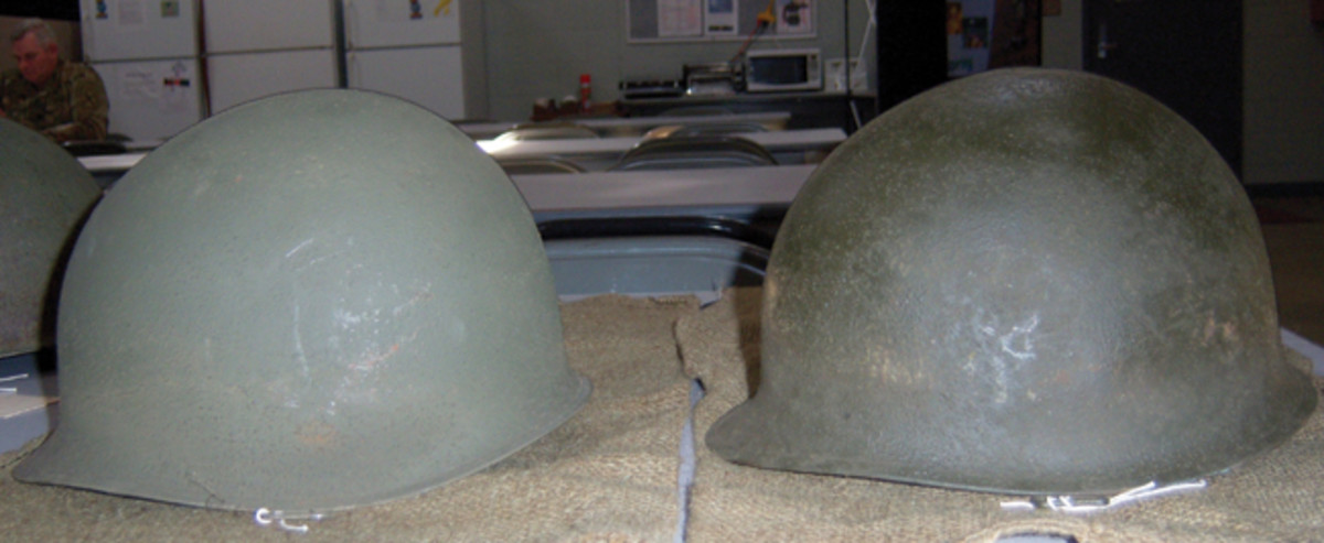 Of the 32 helmets recovered, 3 were made by Schlueter Manufacturing Company, the remaining 29 were McChords. For comparison, a McChord (#16) is shown on the left next to a Schleuter (#24). The differences in the width and angle of the brims are easily seen.