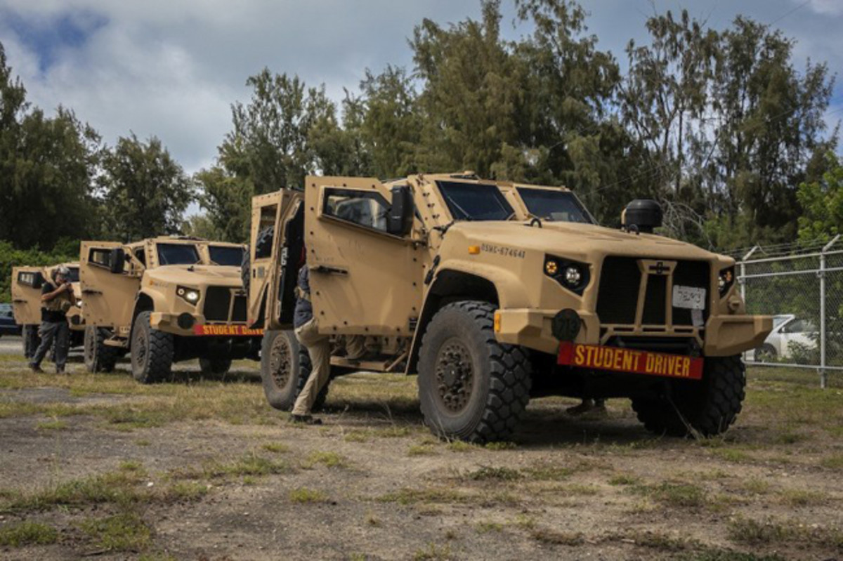 U.S. Marines with 3d Marine Regiment and Joint Light Tactical Vehicle (JLTV) instructors enter JLTV's during a JLTV field training exercise, Marine Corps Training Area Bellows, July 29, 2019. The JLTV Family of Vehicles is a U.S. Army led, joint acquisition program with the U.S. Marine Corps. The program is intended to close an existing, critical capability gap in the services' light tactical wheeled vehicle fleets. (U.S. Marine Corps photo by Cpl. Matthew Kirk)