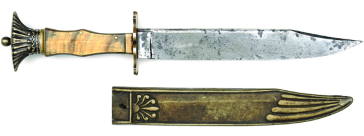 "A very rare pre-Civil War Indian bonnet Sheffield Arkansaw bowie knife, etched on blade ""Death to Abolition."" This rare bowie in fine condition is estimated at a conservative $20-30,000."