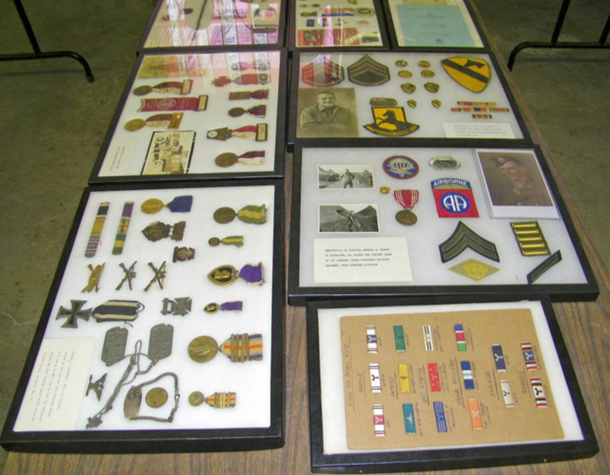 Several lots of preserved memorabilia including medals, insignia, and patches realized strong prices.